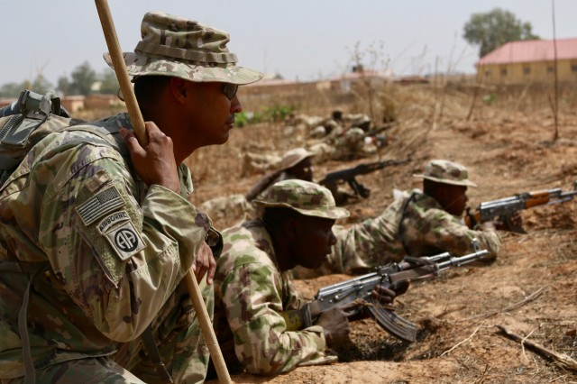 Twelve U.S. Army Soldiers share tactics and training with a little over 200 Nigerian Army Soldiers from 26th Infantry Battalion in a remote military compound four hours north of the capital in Jaji. The seven- week training includes reacting to an IED, react to an ambush, securing an objective, operations planning, etc. The training's significance cannot be underestimated. These Nigerian Soldiers may eventually use these tactics when forward-deployed to fight against the violent terrorist organization, Boko Haram.Nigerian Advanced infantry training has significant implications outside of on-the-ground tactical maneuvers. This bilateral military-to-military training carries diplomatic weight showcasing the U.S.'s commitment to its African partners and Nigeria's commitment to countering violent extremist organizations.