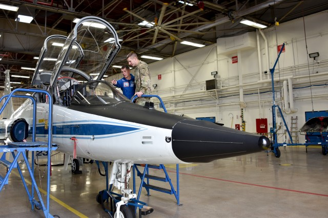 Retired Army Col. Shane Kimbrough, NASA astronaut, describes some of the features of the T-38 jet which is used to train astronauts for spaceflight to Sgt. Maj. of the Army Daniel Dailey during his visit to the Army Astronaut Detachment at the Johnson Space Center in Houston, Texas, Feb. 28.