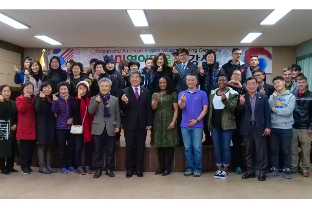 Participants of the Dongducheon Volunteer Center English Class take a group photo during the opening ceremony of the program at the Dongducheon Volunteer Center Feb. 27, 2018. The program was organized to teach conversational English to participants, as well as strengthen the relationship with U.S. Army Soldiers and local citizens. (U.S. Army photo by Sgt. Michelle U. Blesam, 210th FA Bde PAO)