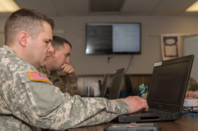 Soldiers from the 146th Cyber Support Team of the Maine Army National Guard train to hack into other computers at Camp Keyes in Augusta, Maine on February 4, 2018.  The 146th Cyber Support Team was created in October of 2017 to increase the safety of the Maine Guard's technological assets.