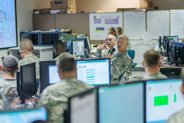 Brig. Gen. David Elwell, commanding general of the 311th Sustainment Command (Expeditionary), speaks to his staff during the Command Post Exercise-Functional at Camp Parks, Calif., on Sept. 20, 2015. The exercise uses a closed computer network to simulate the operation of a command post within a simulated theater of operation. Simulations like this are provided through the Simulation Training Center at Fort Lee, Virginia.