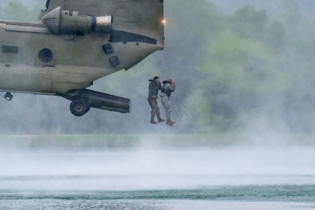 Teams jump from a military aircraft into Training Area 250 during the 2017 Best Sapper Competition at Fort Leonard Wood.