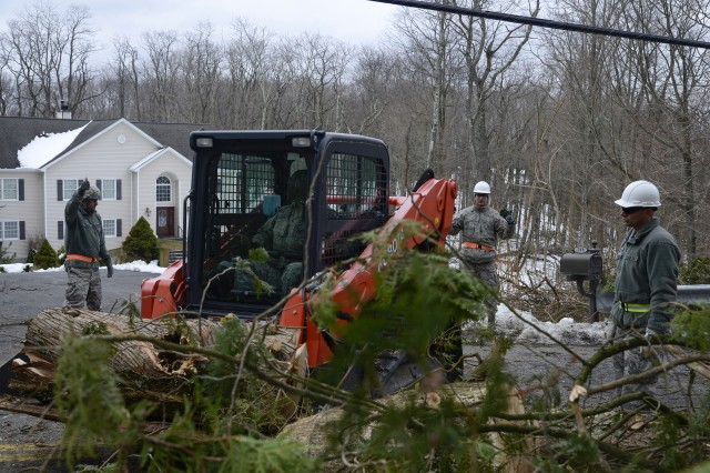 Twenty Airmen assigned to the 105th Airlift Wing deployed to Putnam County, New York, to help town and county workers clear debris from roadways. The county was hit hard with a winter storm knocking down trees and causing widespread power outages.
