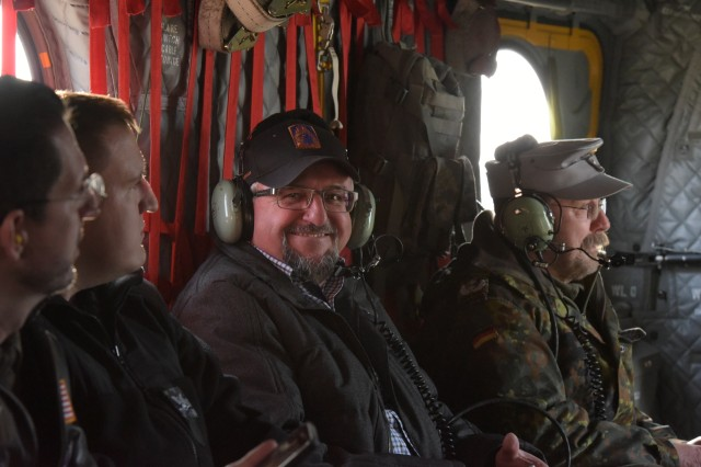 Herr. Heinrich Forster, Mayor of Illesheim, smiles during an observation flight on a CH-47 Chinook helicopter from Bravo Company, 1st Battalion, 214th Aviation Regiment, 12th Combat Aviation Brigade, Mar. 05, 2018.  Dynamic Front 18 is a U.S. Army-led exercise focusing on the integration of joint fires and allied artillery interoperability at the Grafenwoehr Training Area, Feb. 23 - March 10, 2018.