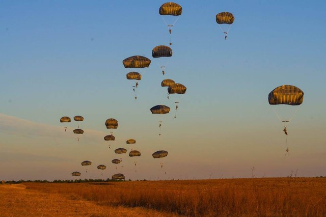 Note: Initial entry photo for illustration purposes only; Transportable Tactical Command Communications (T2C2) was not used during this event. The 1st Battalion, 508th Parachute Infantry Regiment, 3rd Brigade Combat Team, 82nd Airborne Division, conduct airborne proficiency jump onto a drop zone at Fort Bragg, North Carolina, in December 2017.