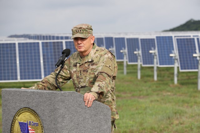 Lt. Gen. Paul Funk II, III Corps and Fort Hood commanding general, speaks during the Fort Hood renewable energy project ribbon cutting ceremony at the Phantom Solar farm in June 2017. In FY17, Fort Hood completed installation of a 15 megawatt (MW) solar PV array and a 50 MW off-site wind power generation in FY17. It is the Army's largest and first hybrid renewable energy project. The 30-year PPA will ensure a minimum annual requirement of 230 gigawatt hours of renewable electric energy, providing more than 40 percent of the installation's annual energy usage.