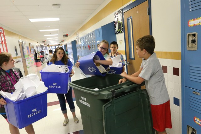 Students gather around a large recycle container with bins collected from each of the classrooms. The Kids Care Club and Student Council at Clements/Parsons Elementary School organized weekly pickups and created a recycle campaign, winning second place and recycling 4,085 pounds of recyclables. In FY17, recycle champions from Fort Hood, Copperas Cove, and Killeen collected more than 14,750 pounds of recyclables.