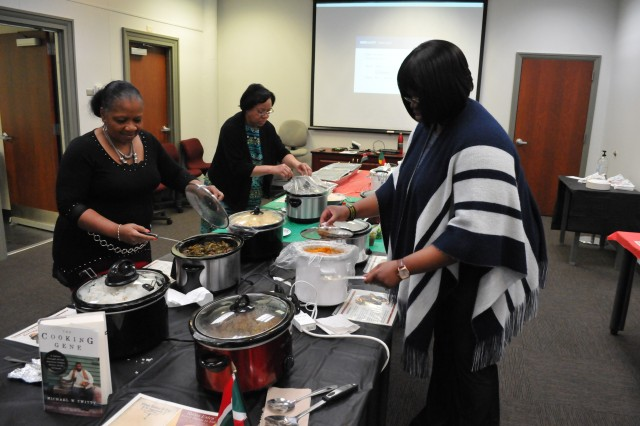 Black History Program volunteers serve African-American samples of food after the program.  (Photo Credit: Eldria Coleman, JMC Public and Congressional Affairs.)