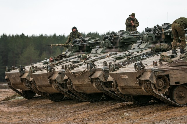 Marders, German infantry fighting vehicles, assigned to 1st  Mechanized Infantry Company, Enhanced Forward Presence Battle Group Lithuania, are positioned during the multinational rapid response exercise simulated training event with U.S. Soldiers Dec. 14, 2017, near Baltadvaris, Lithuania. The rapid response exercise enhances the United States' abilities to conduct training operations in cooperation with our NATO allies and partners. (U.S. Army photo by Spc. Dustin D. Biven / 22nd Mobile Public Affairs Detachment)