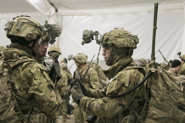 1st Lt. James Dicesare (right), a platoon leader with 5th Squadron, 4th Cavalry Regiment, 2nd Armored Brigade Combat Team, 1st Infantry Division, Fort Riley, Kansas prepares his team before a tactical dismounted movement in Lithuania, Dec. 13, 2017. The United States' presence, movement and training across Europe demonstrates its commitment to NATO allies and sends a powerful message to potential adversaries of our resolve to preserve security and stability in the region. (U.S. Army Staff Sgt. Sharon Matthias/ 22nd Mobile Public Affairs Detachment)
