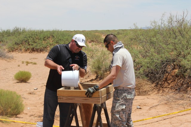 Military Police and CID agents learn how to screen for evidence.  The Agents were taught how to properly screen for evidence, such as bullets, bone fragments, or teeth.  Using archaeological methods and techniques, the participants completed a forensic excavation of a mock burial on Fort Bliss.