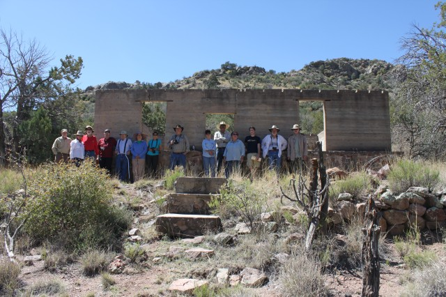 Members of the Dona Ana County Historical Society pose at the Beasley House in Soledad Canyon.  The Society was granted a field trip by the Garrison Commander to view the historic ranch homes in the canyon.  Fort Bliss Senior Archaeologist and Architect Tech accompanied the group and answered questions.