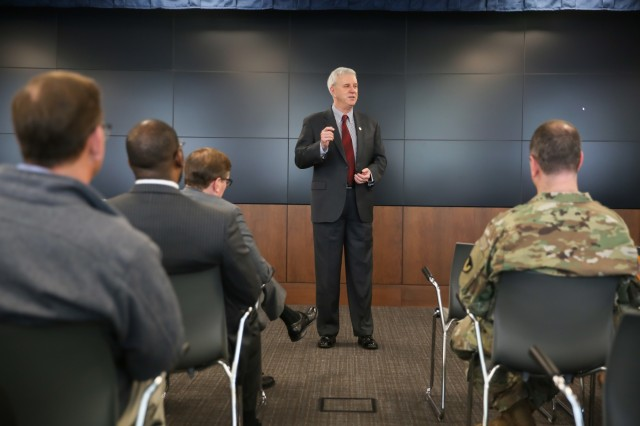 Hon. James McPherson, General Counsel of the U.S. Army, answer questions during a town hall meeting with Soldiers and civilians from the Army Materiel Command at Redstone Arsenal, Alabama, Feb. 26, 2018. (U.S. Army photo by Sgt. 1st Class Teddy Wade)