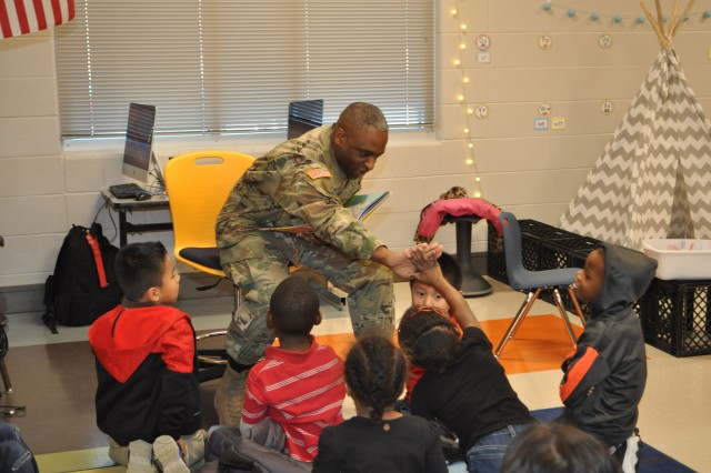 Maj. Rontario Hicks high fives members of the kindergarten class at Morris P-8 that he just finished reading to for Read Across America on March 2. ACC has a partnership with Morris, its adopted local school, and this is the fifth year that it has participated in the Dr. Seuss celebration. Twenty-seven ACC employees read to students in grades pre-kindergarten through 5th grade.