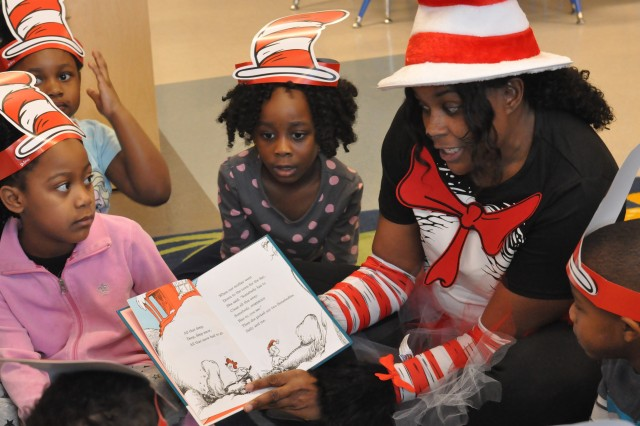 Dressed the part, Sgt. 1st. Class Jewel Loving read Cat In the Hat to a pre-K class at Morris P-8 for Read Across America on March 2. ACC has a partnership with Morris, its adopted local school, and this is the fifth year that it has participated in the Dr. Seuss celebration. Twenty-seven ACC employees read to students in grades pre-kindergarten through 5th grade.