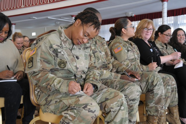 Sgt. 1st Class Tonya Price, 21st Theater Sustainment Command writes down how she relieves stress during the Sisters-in-Arms inaugural meet and greet, March 5, at the Armstrong's Club on Vogelweh housing complex.
