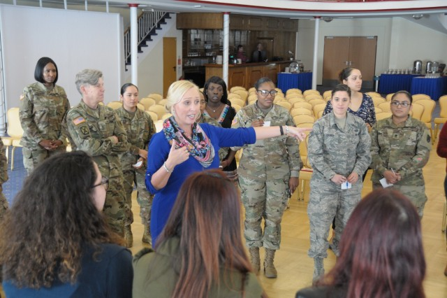Jennifer Streeter, 30th Medical Brigade SHARP Victim Advocate demonstrates with attendees of Sisters-in-Arms meet and greet how it is impossible to identify commonalities unless we are willing to share through a group activity, March 5 at the Armstrong's Club on Vogelweh housing complex.