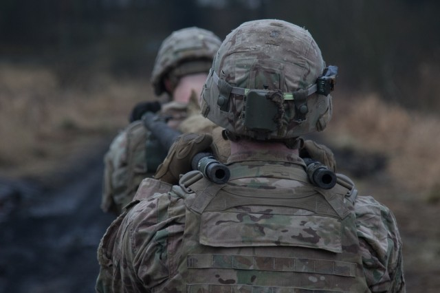 U.S. Soldiers assigned to the 3rd Squadron, 2nd Cavalry Regiment of Battle Group Poland carry a weighted litter on the second day of the unit's 3-day sniper school try-outs in Bemowo Piskie, Poland, Jan. 3, 2018. These Soldier are a part of the unique, multinational battle group, comprised of U.S., U.K., Croatian and Romanian soldiers who serve with the Polish 15th Mechanized Brigade as a deterrence force in northeast Poland in support of NATO's Enhanced Forward Presence. (U.S. Army photo by Spc. Andrew McNeil / 22nd Mobile Public Affairs Detachment)