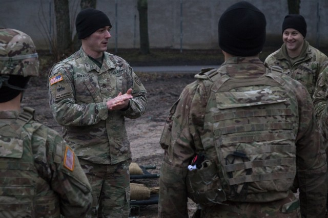 Staff Sgt. Cameron Angers, the sniper section leader assigned to Headquarters and Headquarters' Troop, 3rd Squadron, 2nd Cavalry Regiment, briefs Soldiers on the tasks involved in the litter carry event on the second day of the unit's 3-day sniper school try-outs in Bemowo Piskie, Poland, Jan. 3, 2018. These Soldier are a part of the unique, multinational battle group, comprised of U.S., U.K., Croatian and Romanian soldiers who serve with the Polish 15th Mechanized Brigade as a deterrence force in northeast Poland in support of NATO's Enhanced Forward Presence. (U.S. Army photo by Spc. Andrew McNeil / 22nd Mobile Public Affairs Detachment)180103-A-OL598-0107