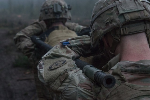 U.S. Soldiers assigned to the 3rd Squadron, 2nd Cavalry Regiment of the Battle Group Poland carry a weighted litter on the second day of the unit's 3-day sniper school try-outs in Bemowo Piskie, Poland, Jan. 3, 2018. These Soldier are a part of the unique, multinational battle group, comprised of U.S., U.K., Croatian and Romanian soldiers who serve with the Polish 15th Mechanized Brigade as a deterrence force in northeast Poland in support of NATO's Enhanced Forward Presence. (U.S. Army photo by Spc. Andrew McNeil / 22nd Mobile Public Affairs Detachment)