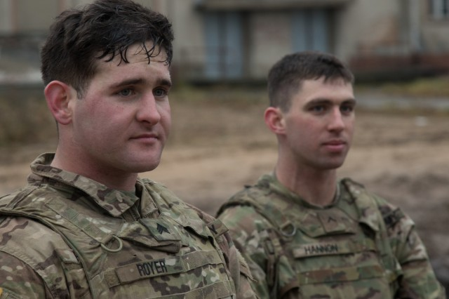 Sgt. Shawn Royer (left) and Pvt. Wes Hannon (right), U.S. Soldiers assigned to Lightning Troop, 3rd Squadron, 2nd Cavalry Regiment, finish the litter carry event on the second day of the unit's 3-day sniper school try-outs in Bemowo Piskie, Poland, Jan. 3, 2018. Royer a Millington, Tenn. native and Hannon a Buford, Ga. native are part of the unique, multinational battle group, comprised of U.S., U.K., Croatian and Romanian soldiers who serve with the Polish 15th Mechanized Brigade as a deterrence force in northeast Poland in support of NATO's Enhanced Forward Presence. (U.S. Army photo by Spc. Andrew McNeil / 22nd Mobile Public Affairs Detachment)
