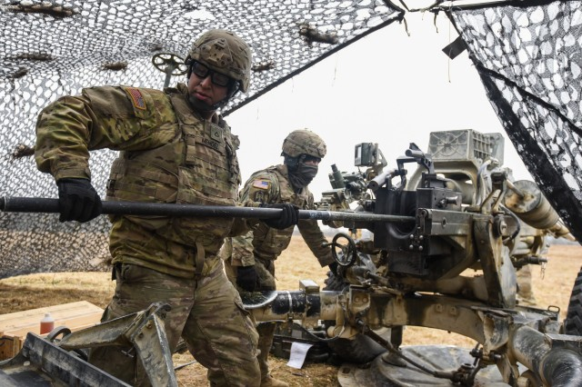U.S. Soldiers with 4th Battalion, 319th Airborne Field Artillery Regiment, 173rd Airborne Brigade conduct a live fire mission as part of exercise Dynamic Front 18 at the 7th Army Training Command's Grafenwoehr training area, Germany, March 06, 2018.