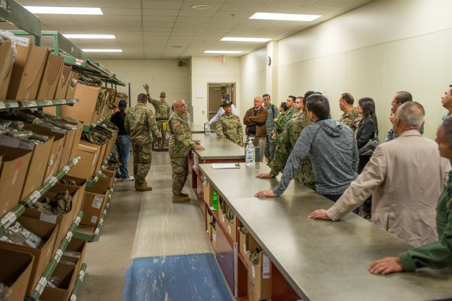 FORT BENNING, Ga. (March 6, 2018) -- Drill sergeants from the 30th Adjutant General (Reception) Battalion gave students from Western Hemisphere Institute for Security Cooperation, or WHINSEC, a tour of their facility March 2. The 30th AG Bn. Designed the tour -- delivered in Spanish -- to highlight their battalion's mission and to strengthen the Maneuver Center of Excellence's partnership with foreign nations. (U.S. Army photos by Patrick Albright, Maneuver Center of Excellence, Fort Benning Public Affairs)