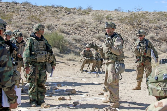 Col. Jonathan Byrom (2nd from right), 3rd Cavalry Regiment commander, directs the regimental staff and squadron commanders at a sustainment rehearsal during the regiment's Decisive Action Rotation 18-04 at the National Training Center in Fort Irwin, Calif. Feb. 15, 2018.