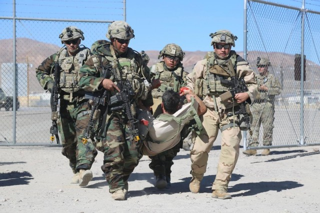 U.S. Army Soldiers assigned to 1st Squadron, 3rd Cavalry Regiment rush a civilian with simulated wounds to a casualty collection point during Decisive Action Rotation 18-04 at the National Training Center in Fort Irwin, Calif., Feb. 8, 2018. (U.S. Army photo by Sgt. John Scarpati, Operations Group, National Training Center)