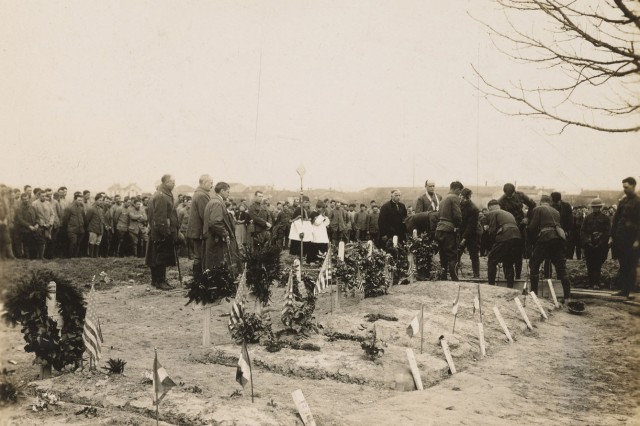 "Father Francis Duffy, Regimental Chaplain of the 165th Infantry Regiment, the Army's famous ""Fighting 69th"" Irish regiment, officiates a funeral service for a Soldier of the 117th Field Signal Battalion of the 42nd Infantry ""Rainbow Division"" March 19, 1918. Duffy spent much of March 1918 officiating for the casualties of the Irish regiment's first combat casualties of WWI, including the 21 Soldiers killed by the Rouge Bouquet artillery barrage March 7, 1918. The Rainbow Division spent March 1918 under French command to gain combat experience in trench warfare of the Western Front. The division would serve in its own sector as a full division combat force in April 1918."