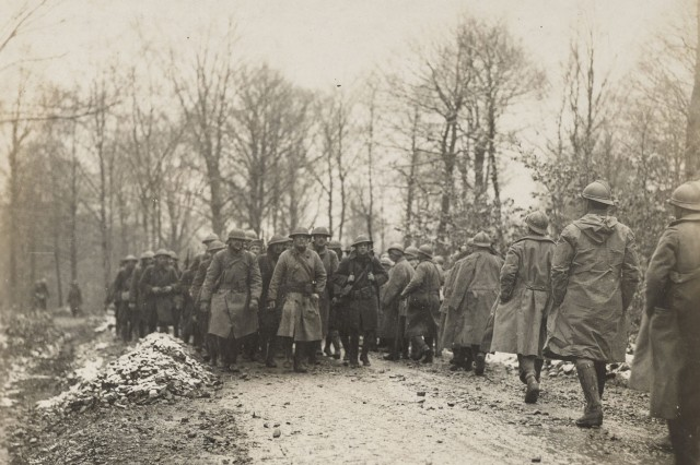 "Soldiers of Company D, 1st Battalion, 165th Infantry Regiment, the Army's famous ""Fighting 69th"" Irish regiment, move into position to replace French troops near Benomenil, France, March 1, 1918. The troops, part of the 42nd Infantry ""Rainbow"" Division, spent March 1918 under French command to gain combat experience in trench warfare of the Western Front. The division would serve in its own sector as a full division combat force in April 1918."