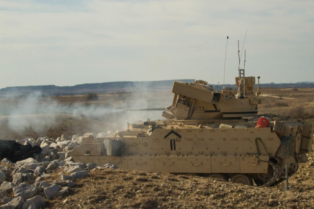 A U.S. Army Bradley Fighting Vehicle belonging to 6th Squadron, 9th Cavalry Regiment, 3rd Armored Brigade Combat Team, 1st Cavalry Division, engages targets from cover during a gunnery table at Fort Hood, Texas Feb. 26, 2018. Third Brigade exemplified the Army's commitment of readiness by being combat ready only three months after returning home after a nine-month deployment to Kuwait. (US Army Photo taken by Spc. Nicholas Vidro, 7th Mobile Public Affairs Detachment.)