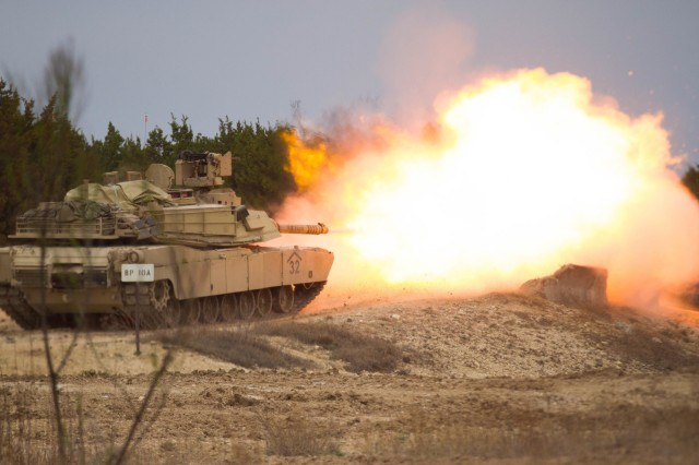 A U.S. Army Abrams Battle Tank belonging to 1st Squadron, 12th Cavalry Regiment, 3rd Armored Brigade Combat Team. 1st Cavalry Division, fires at targets during a gunnery table at Fort Hood, Texas  March 1, 2018. The Soldiers of 3rd Brigade worked hard to show that they could be combat effective following a nine month deployment to Kuwait, reinforcing the Army ideal of readiness. (US Army Photo taken by Spc. Nicholas Vidro, 7th Mobile Public Affairs Detachment.)