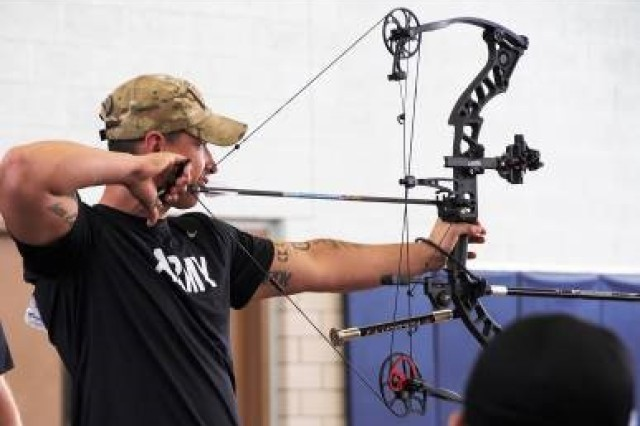 Sgt. Brent Sixkiller draws his compound bow while aiming in during the 2018 Army Trials individual compound gold medal competition at Fort Bliss, Texas, March 5. Over 70 wounded, ill or injured Soldiers and veterans are competing at the Army Trials, March 2-9, for a chance to represent Team Army during the 2018 Warrior Games at Colorado Springs, Colorado, this summer.