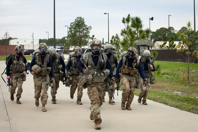 Paratroopers assigned 5th Squadron, 73rd Cavalry Regiment, 3rd Brigade Combat Team, 82nd Airborne Division finish a timed ruck march wearing their chemical protective masks during the brigade's Best Squad Competition held March 6 on Fort Bragg, North Carolina.  The competition tested the paratroopers' physical fitness, grit and technical skill through a series of tasks during a seven-mile ruck march