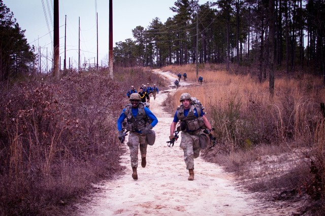 Paratroopers assigned to the 82nd Brigade Support Battalion, 3rd Brigade Combat Team, 82nd Airborne Division run during the brigade's Best Squad Competition held March 6 on Fort Bragg, North Carolina.  The competition tested the paratroopers' physical fitness, grit and technical skill through a series of tasks during a seven-mile ruck march.