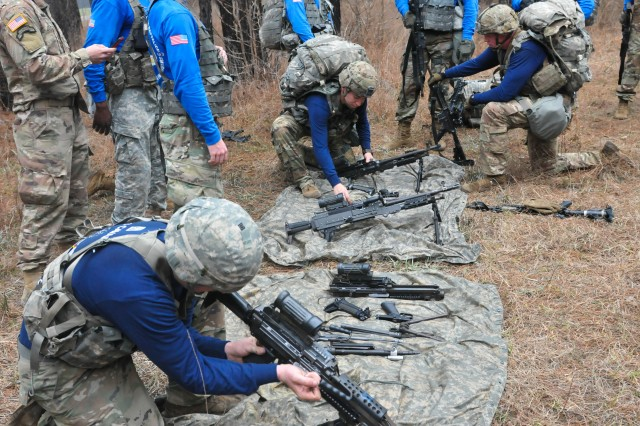Paratroopers assigned to the 307th Brigade Engineer Battalion, 3rd Brigade Combat Team, 82nd Airborne Division conduct a weapons disassembly and assembly test during the brigade's Best Squad Competition held March 6 on Fort Bragg, North Carolina.  The competition tested the paratroopers' physical fitness, grit and technical skill through a series of tasks during a seven-mile ruck march.