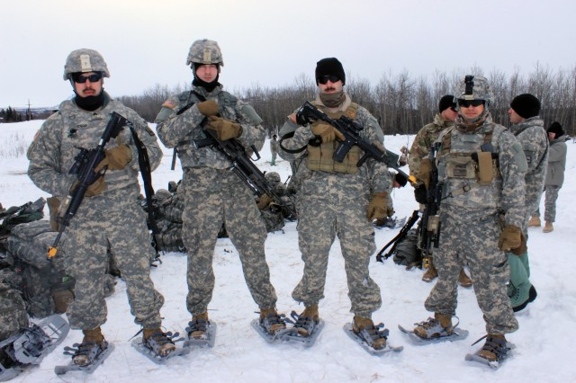 From left to right, Alpha Team Leader Sgt. Taylor Tobar poses with his troops Spc. Travis Smith, a SAW gunner, Spc. Doug Brown, a rifleman, and Spc. Santo Griego, a grenadier, before heading to a live-fire exercise on March 3. Wyoming soldiers from C Company, 1st Battalion, 297th Infantry Regiment participated at Arctic Eagle 2018 Feb. 20 through March 8 for annual training. It was the first time they trained with soldiers from their parent unit based in Alaska.