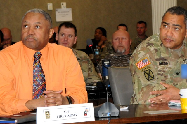 David Cannon (left), First Army deputy G8, and Col. Angel Mesa, United States Army Africa deputy G3, listen to opening remarks during the First Army Training Support and Synchronization Working Group on March 6 in the Pershing Conference Room of First Army headquarters on Rock Island Arsenal, Ill.