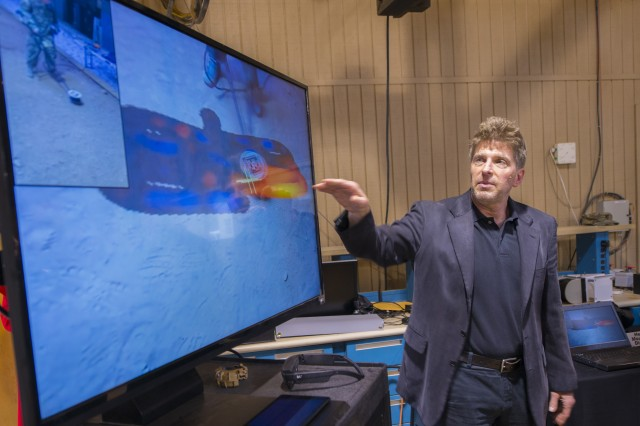 Christopher Marshall, a scientist in the Countermine Division of the Night Vision and Electronic Sensors Directorate, explains how real-time spatial location tracking can display a potential threat in the ground at Fort Belvoir, Va., Feb. 22, 2018.