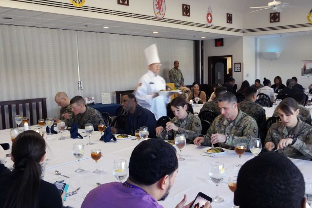 Diners dig into their meals as others wait to be served March 2, 2018, at the Guns and Rockets DFAC. The culinary arts team has been practicing for the Joint Culinary Training Exercise since December.