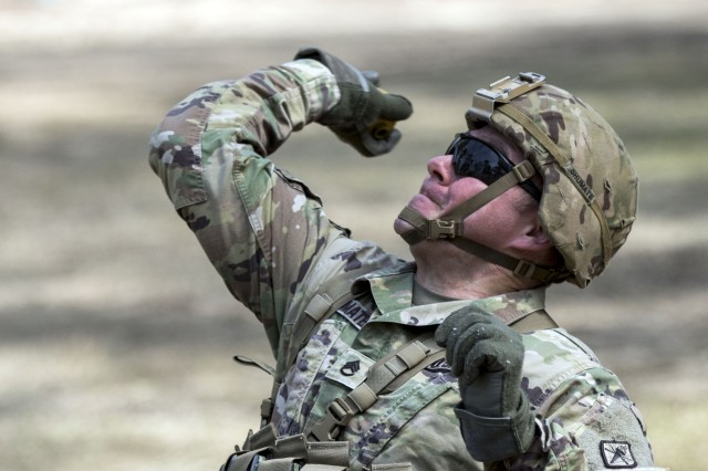 Staff Sgt. Billy Shumate, an infantryman and drill sergeant with Bravo Company, Headquarter and Headquarters Battalion, tosses a dummy grenade during training March 5 for the Expert Infantryman Badge on Fort Jackson.