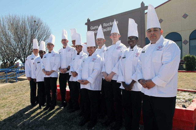 The Fort Sill Culinary Arts Team poses for a group photo March 2, 2018, outside the Guns and Rockets Dining Facility.