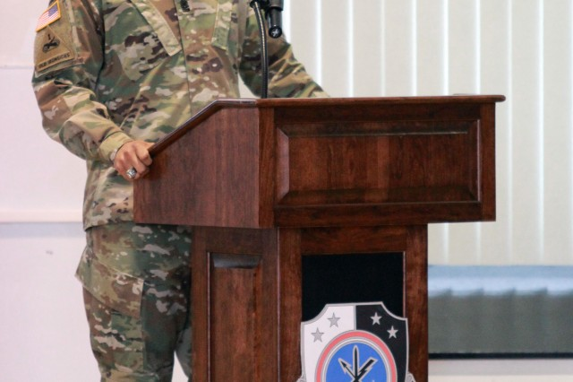 "FORT GEORGE G. MEADE, Md. -- Command Sgt. Maj. Cecil Reynolds (right), the outgoing senior enlisted Soldier for the 781st Military Intelligence Battalion (Cyber), addresses the audience during a Change of Responsibility ceremony at McGill Training Center, March 7. Reynolds will assume the mantle as the senior enlisted Soldier and ""keeper of the colors"" for the 1st Information Operations Command, Fort Belvoir, Virginia, on April 2."