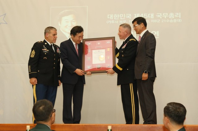 Lt. Gen. Michael A. Bills, Eighth Army commanding general, presents Mr. Lee, Nak-yon, Republic of Korea's Prime Minister, with the 2018 Eighth Army Distinguished Former KATUSA Award. The award recognizes a KATUSA veteran who continues to serve and make significant contributions to the Korean society.