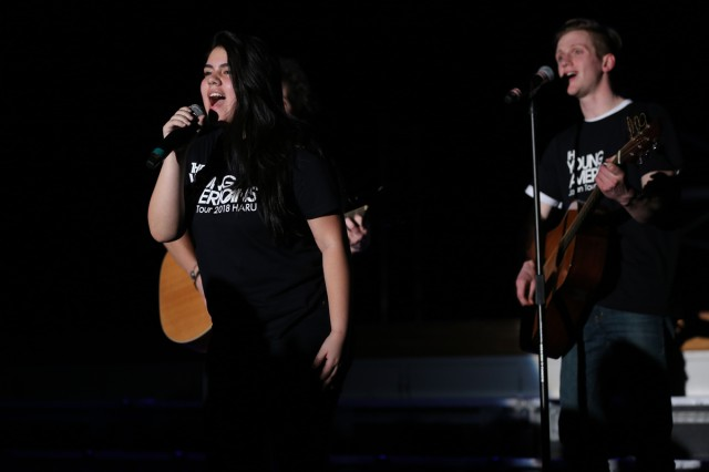 Jinara Otero-Rodriguez, left, 12th-grader at Zama American Middle-High School, sings a solo in The Young Americans' musical show held March 1, 2018 at Arnn Elementary School's cafeteria on Sagamihara Family Housing Area. (U.S. Army photo by Noriko Kudo)