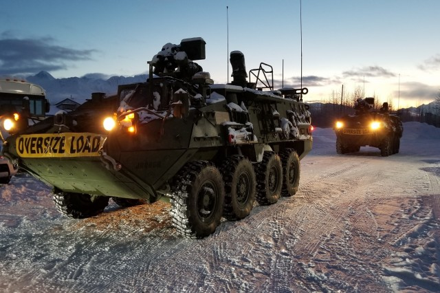 Two Stryker vehicles prepare to depart on an exercise mission to detect notional radiological material from a fictional satellite that has fallen out of orbit and crash landed in Valdez, AK during Arctic Eagle 18. Arctic Eagle 18 is a statewide exercise involving national, state and local agencies designed to provide opportunities for participants to conduct sustained operations in arctic conditions.