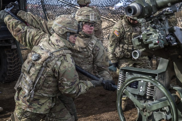 US Army gunners from Archer Battery, 2nd platoon, 4th section, Field Artillery Squadron, 2nd Cavalry Regiment carry out a mission on the M777 howitzer during exercise Dynamic Front 18, Feb. 23 - March 10, 2018.