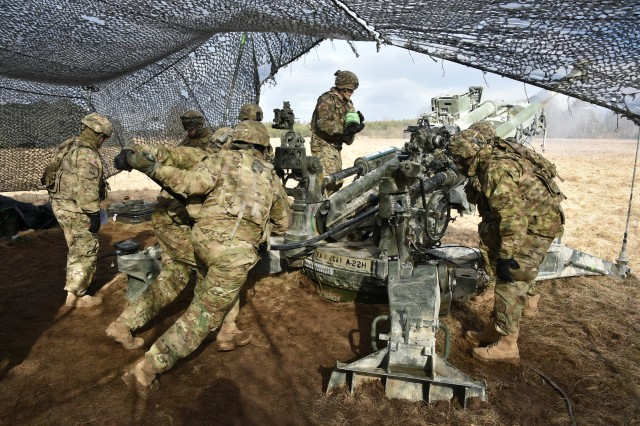 U.S. Army Soldiers with Archer Battery, Field Artillery Regiment, 2d Cavalry Regiment conduct a fire mission with a M777 Howitzer during Exercise Dynamic Front 18 at the U.S. Army's Grafenwoehr Training Area (Germany), March 08, 2018. Exercise Dynamic Front 18 includes approximately 3,700 participants from 26 nations at the U.S. Army's Grafenwoehr Training Area (Germany), Feb. 23-March 10, 2018.