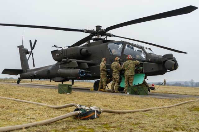 Armament and avionics maintainers with Company D, 1st Attack Reconnaissance Battalion, 227th Aviation Regiment, 1st Air Cavalry Brigade, 1st Cavalry Division, load and prepare an AH-64 Apache helicopter crew's M230 30mm chain gun for gunnery training at an airfield near Grafenwoehr, Germany, Mar. 6, 2018. Troopers of the battalion are conducting gunnery tables and providing aerial fire support during the duration of Dynamic Front 18, an annual U.S. Army Europe exercise focused on strengthening interoperability of U.S. Army, joint service and allied nation artillery and fire support in a multinational environment.